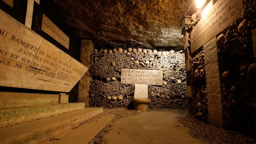 Bone lined halls in the catacombs of Paris.