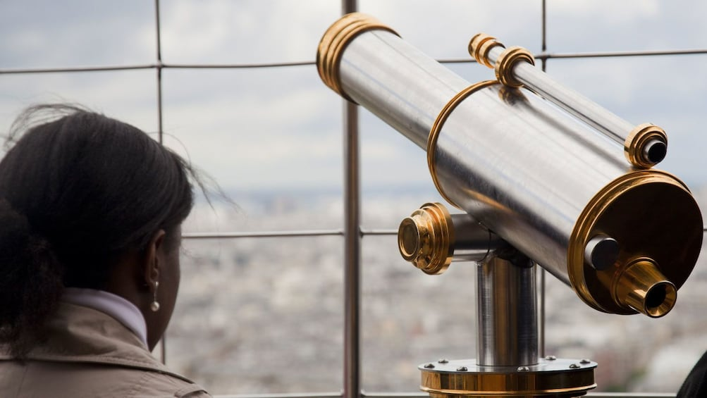 Show item 2 of 10. Telescope for viewing Paris from the Eiffel tower.