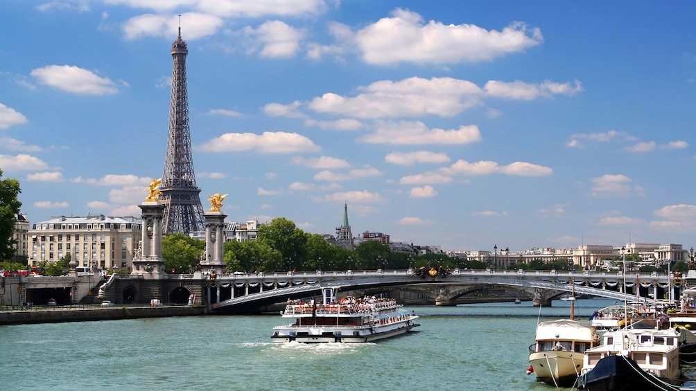 Show item 10 of 10. Sailing past the Eiffel tower on the Seine river.