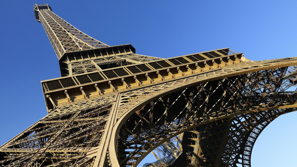Show item 1 of 10. Looking up at the Eiffel Tower.