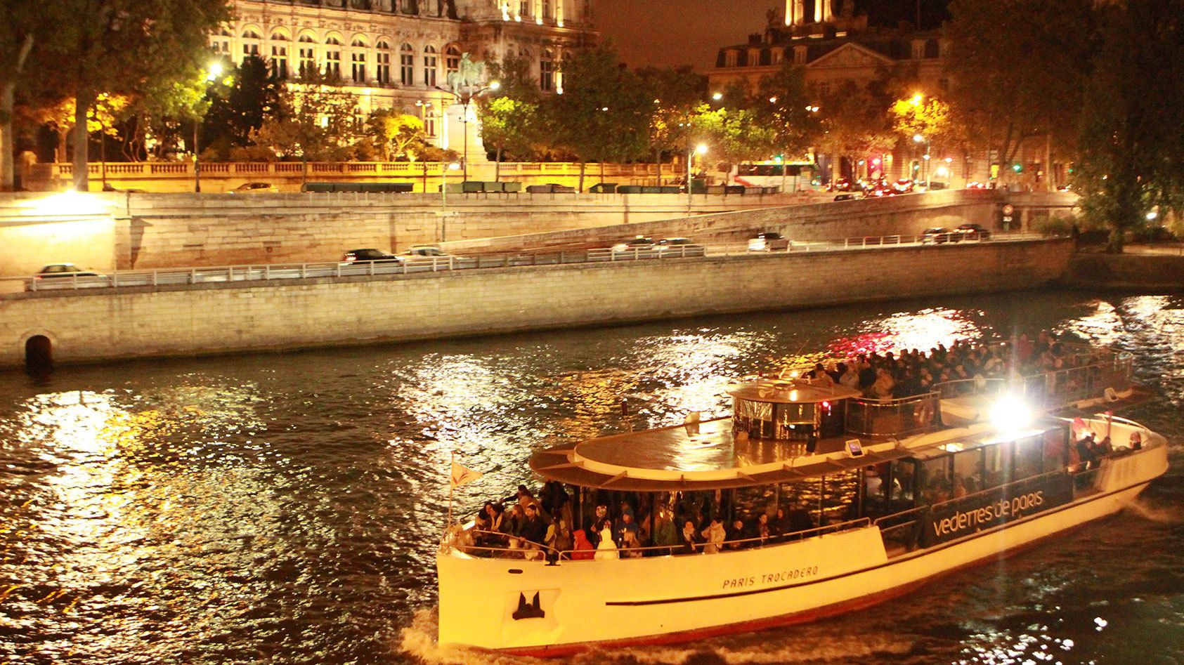 Sailing down the Seine at night.