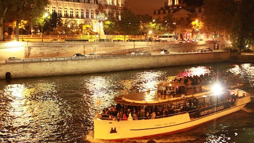 Sailing down the Seine at night.