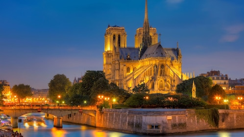 Notre Dame from the Seine River at night.