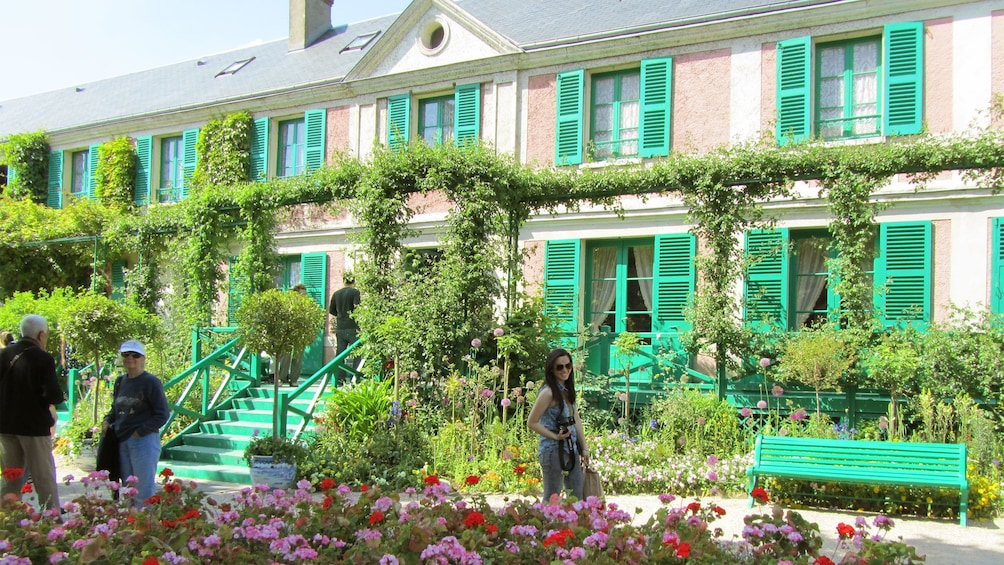 Lush flowers and bright green windows of Giverny.