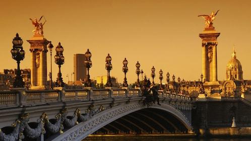 Ornate bridge on the Seine river at sunset.