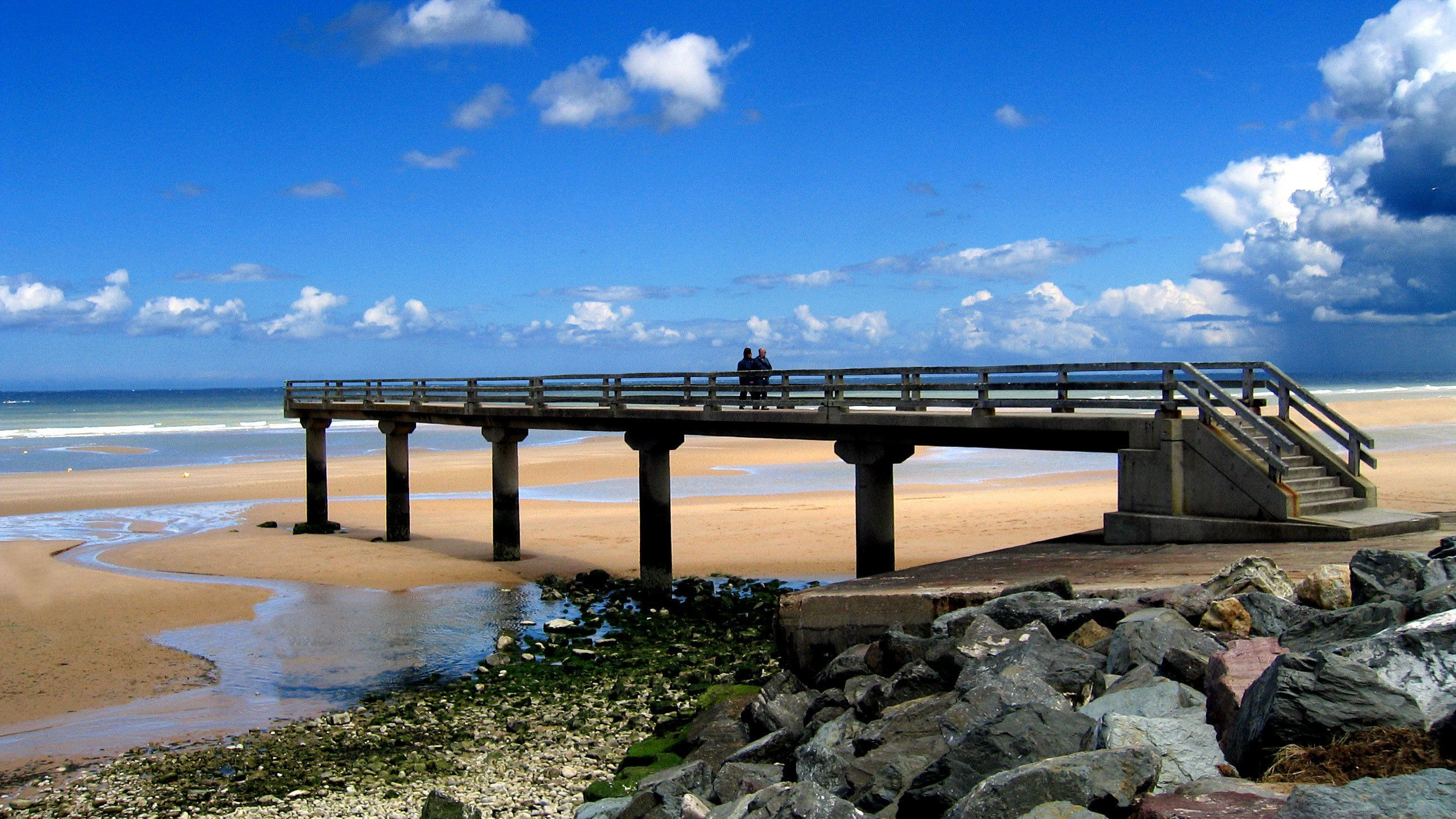 Concrete pier and jetty at Normandy beach.