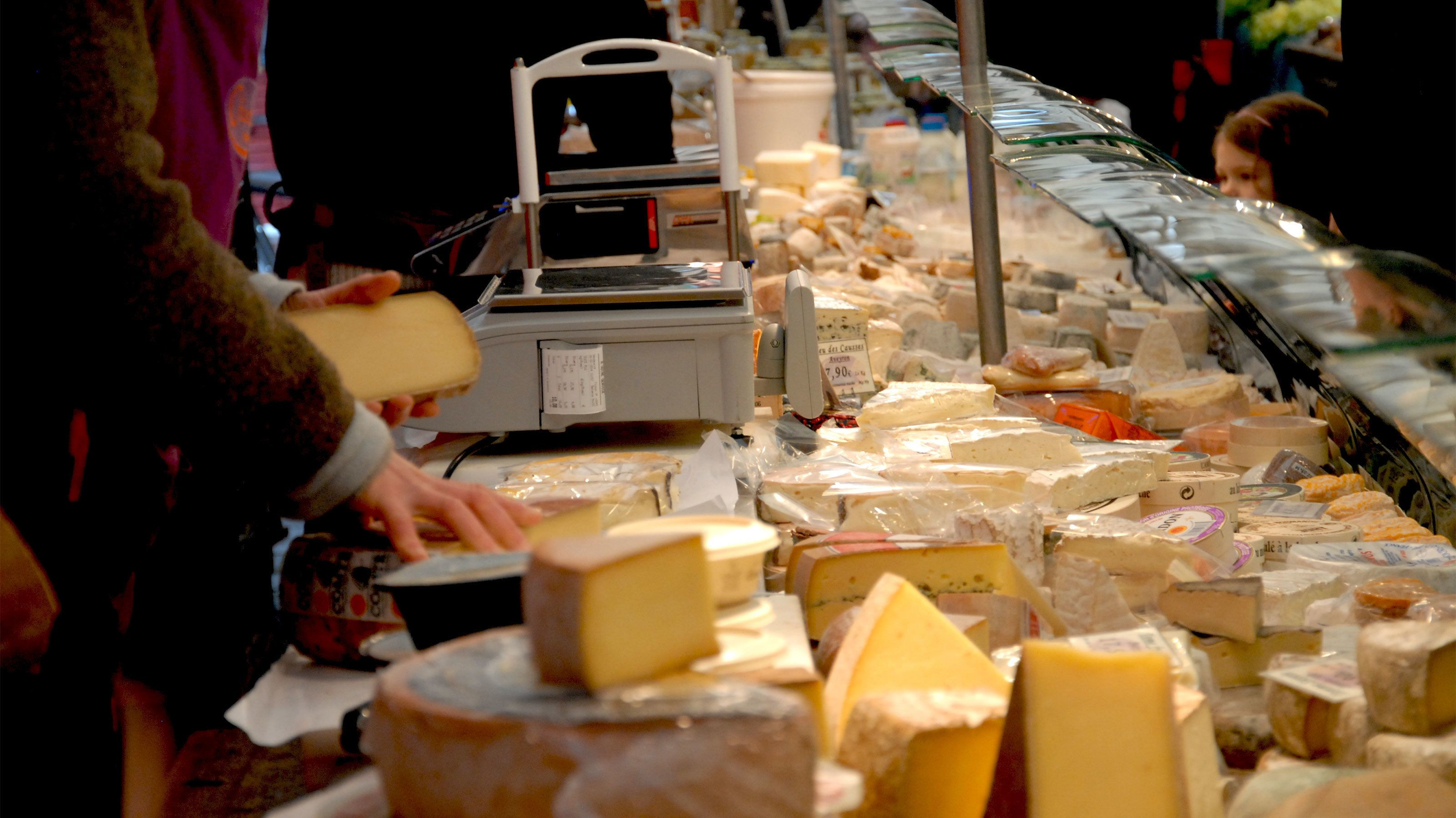 Wheels of cheese for sale at a Paris market