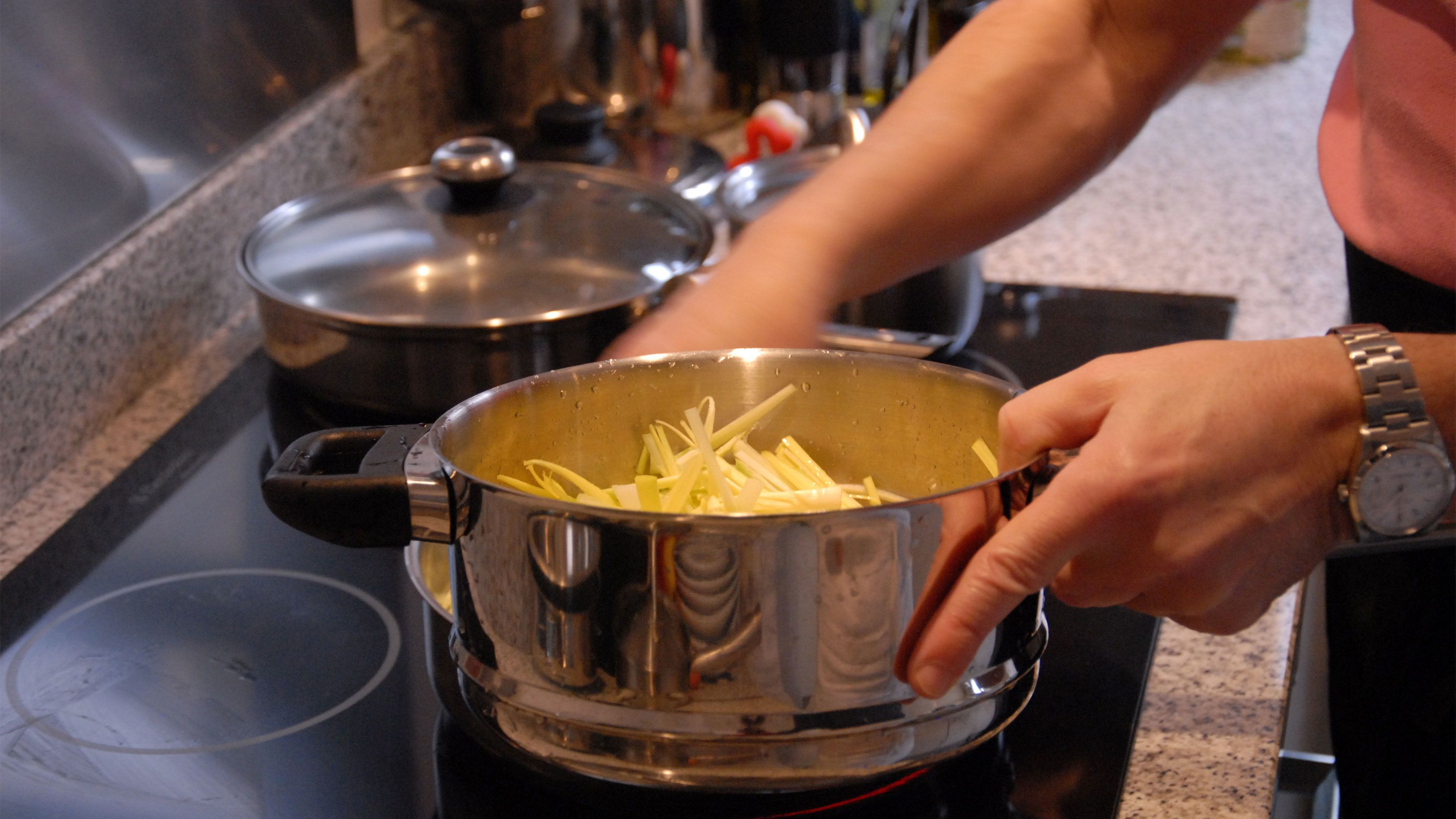 Cooking vegetables over a stove