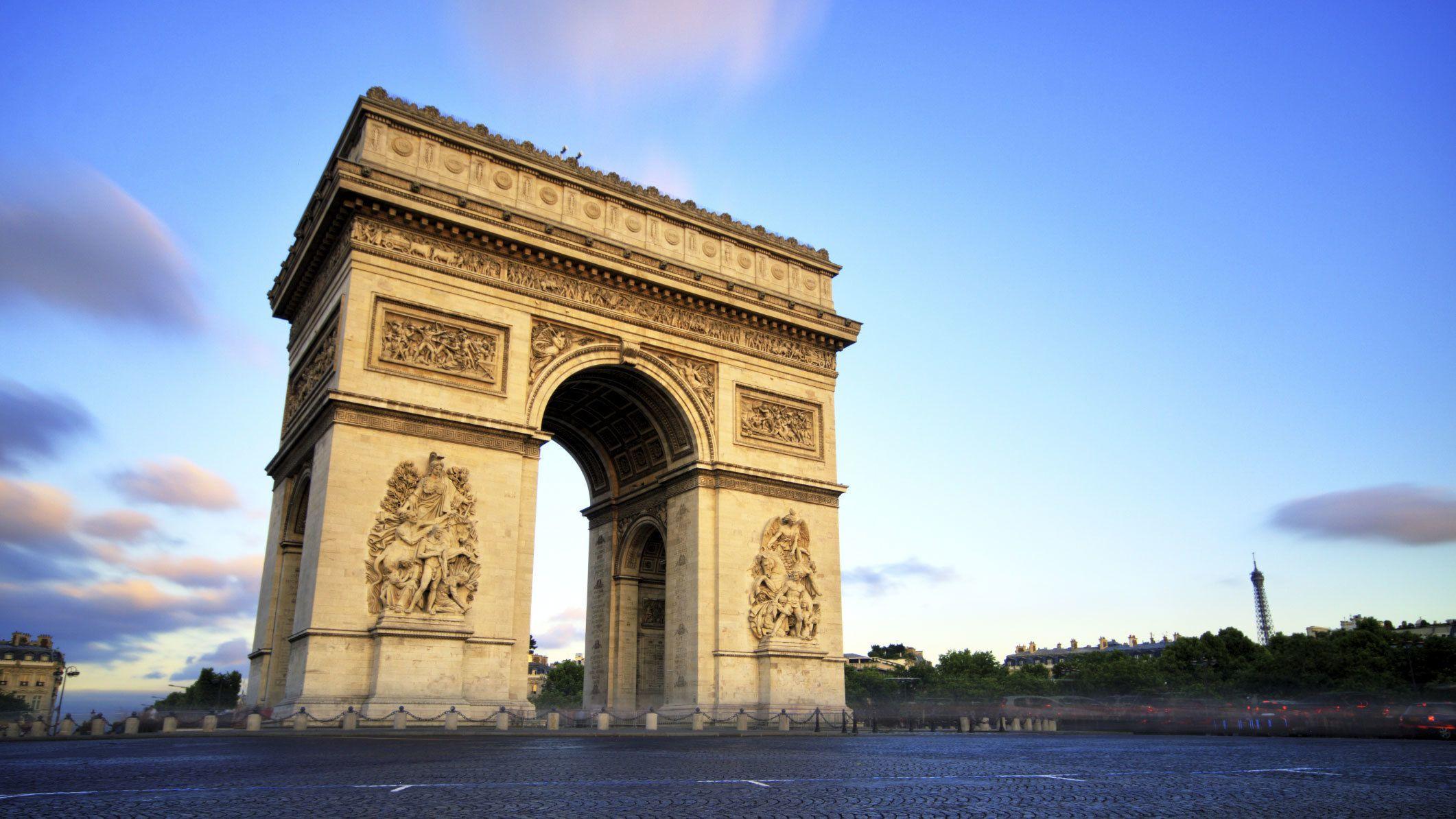 View of the Arc de Triomphe at dusk in Paris