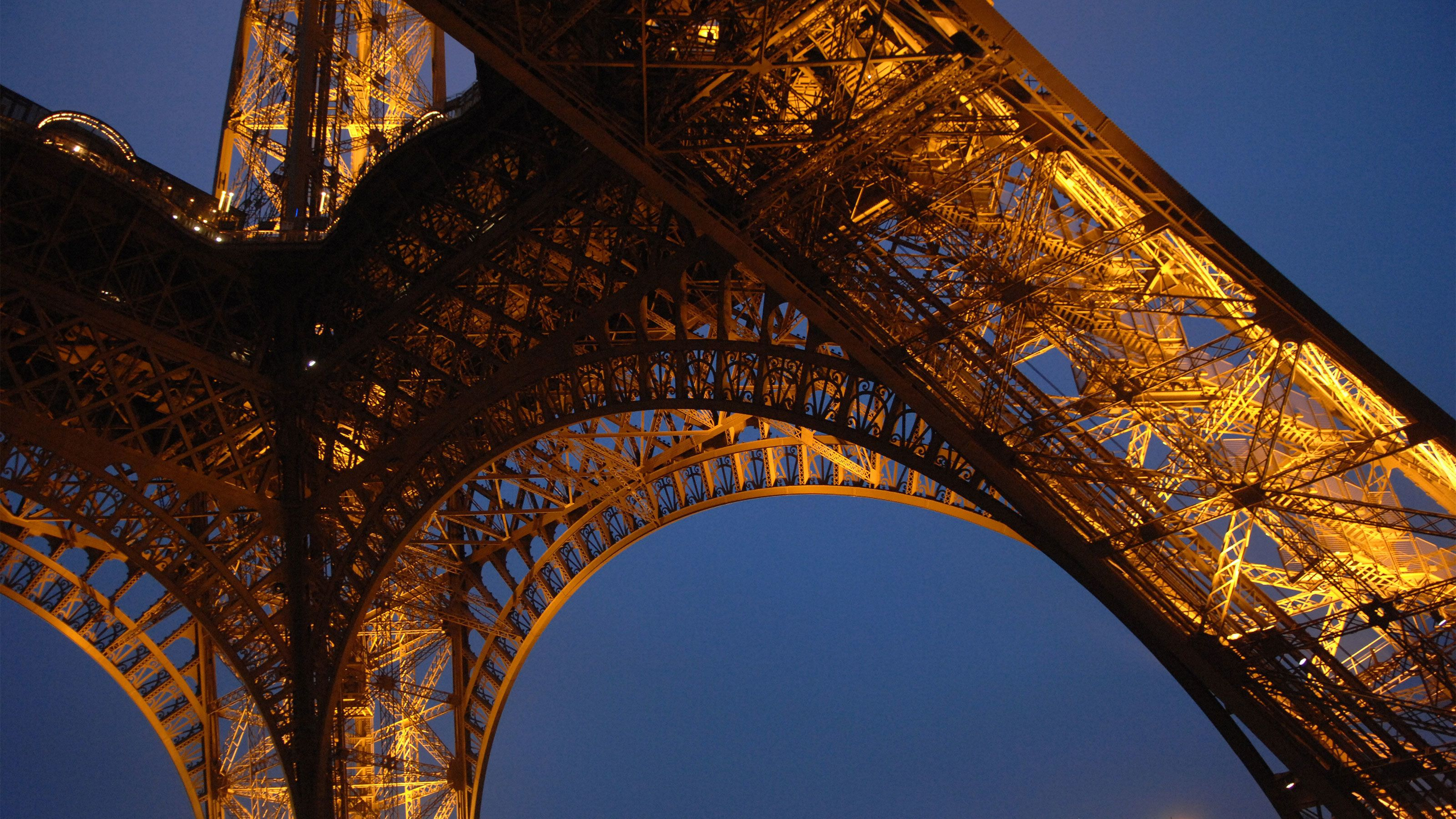 Detail of the Eiffel Tower at night.