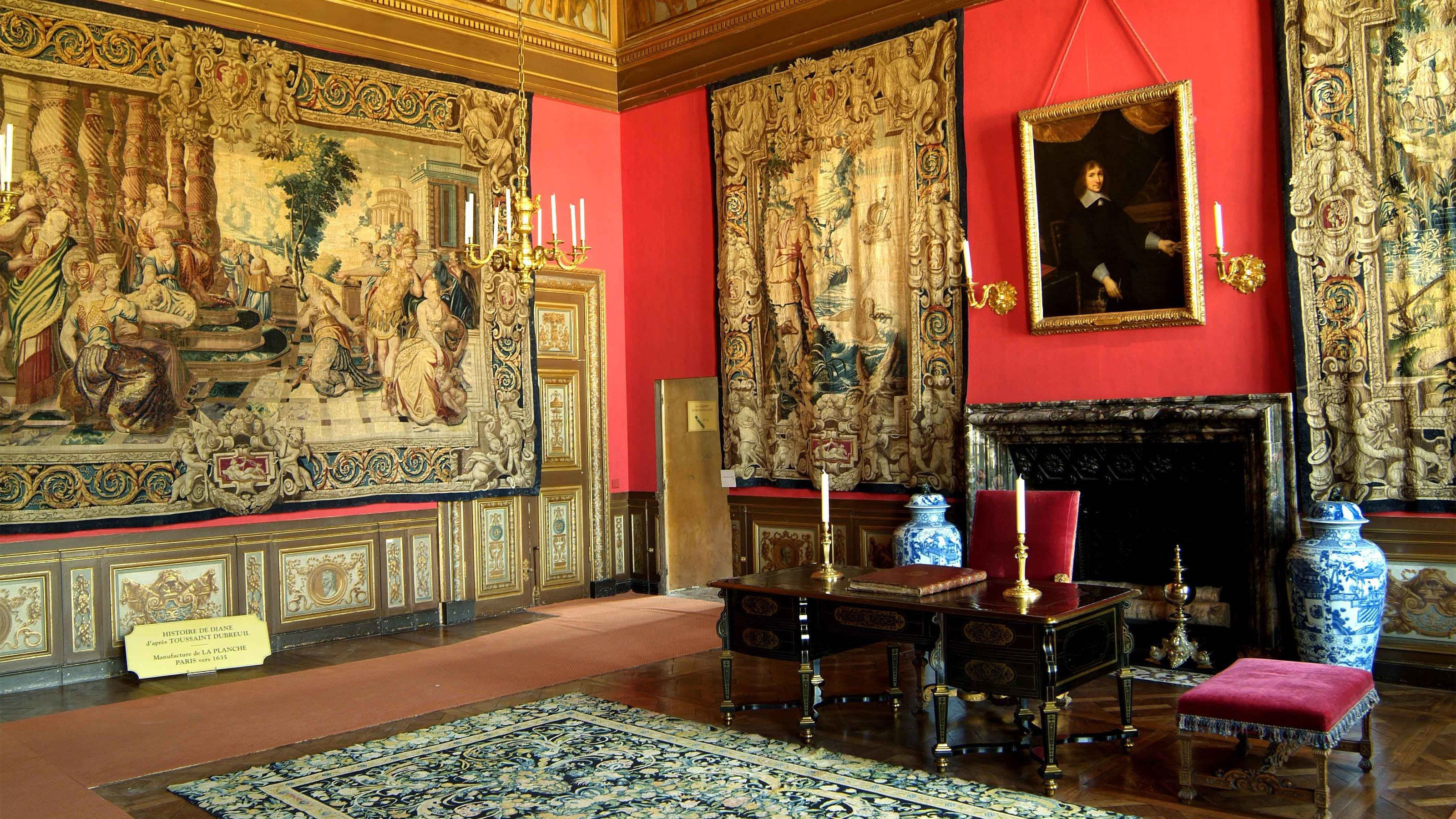 Tapestry covered walls inside Vaux Le Vicomte.