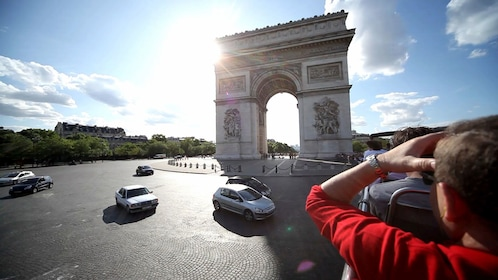 Driving past the Arc de Triomphe in Paris.