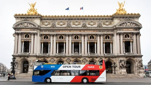 Hop-On Hop-Off bus in front of historical building during tour in Paris