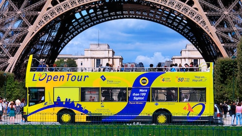 Paris Hop-On Hop-Off Bus next to Eiffel tower