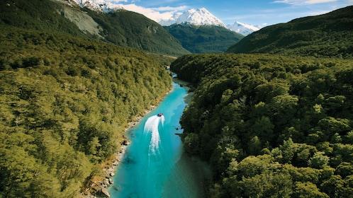 the jet safari boat speeding through a narrow river in New Zealand