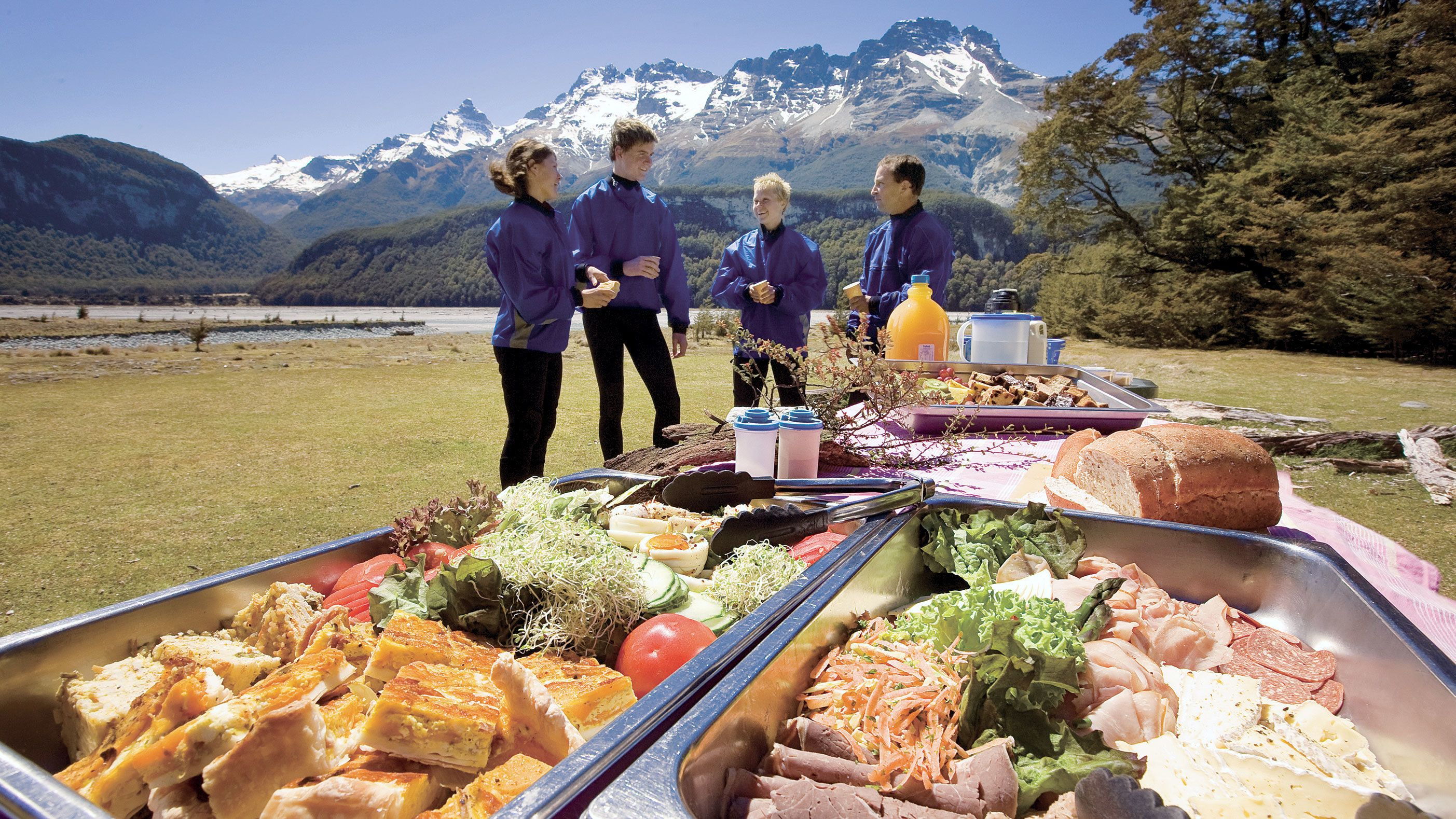 enjoying buffet styled lunch out in the open in New Zealand