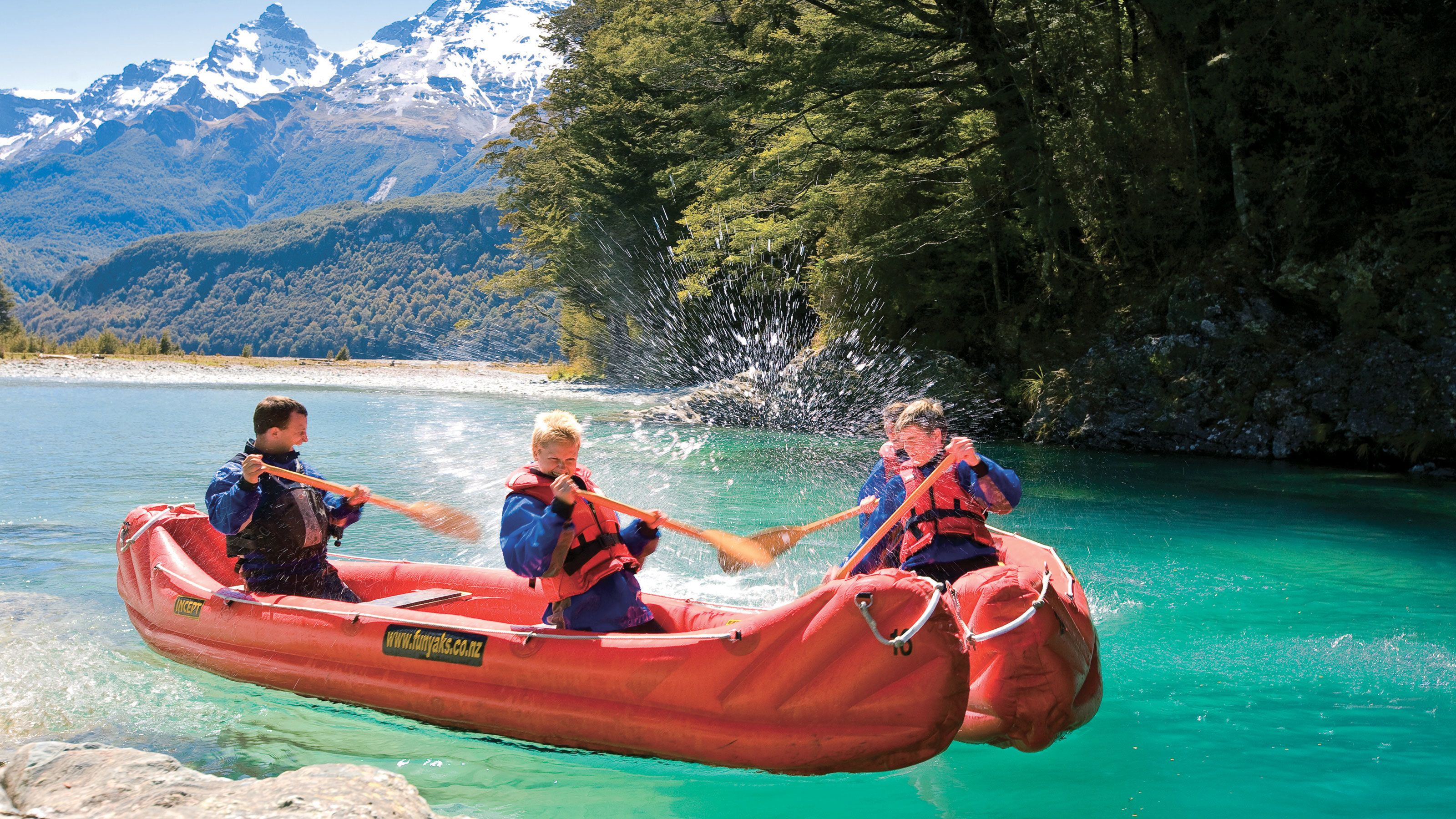 group paddling inflatable canoes in New Zealand