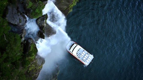 flying over a cruise ship near the waterfall in New Zealand