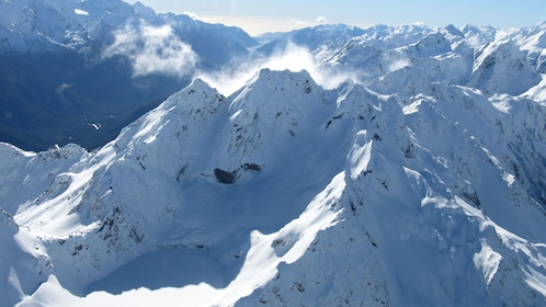 flying over snowy mountain caps in New Zealand