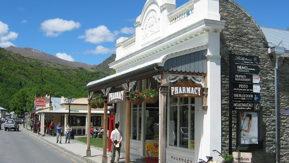 Show item 5 of 5. small retail stores along the street in New Zealand