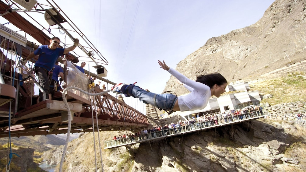 Show item 3 of 5. woman bungee jumping in New Zealand