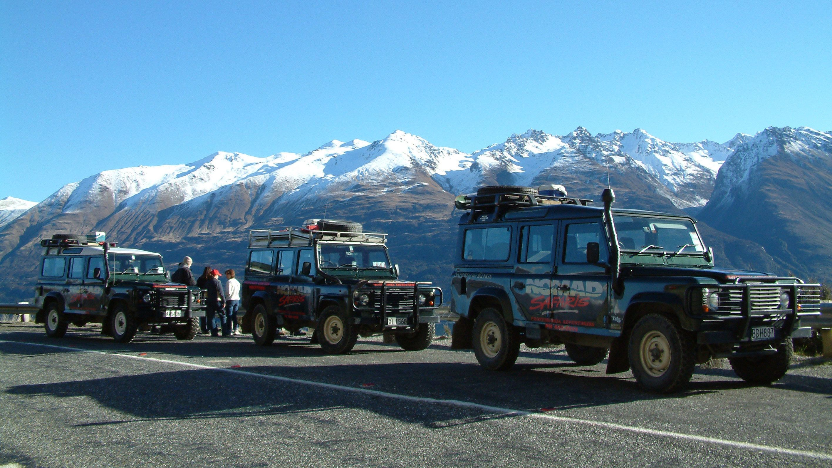 safari vehicles parked in New Zealand