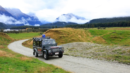 riding a safari vehicle on a gravel road in New Zealand
