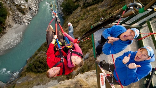harnessed couple on the canyon swing in New Zealand
