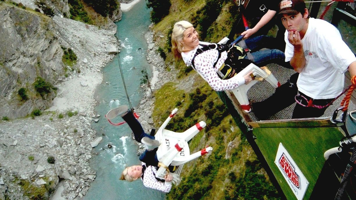 woman on chair bungee jumping in New Zealand