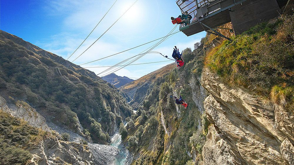 individuals on the canyon swing in New Zealand
