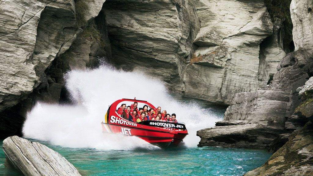 jet boat making way through narrow paths in New Zealand