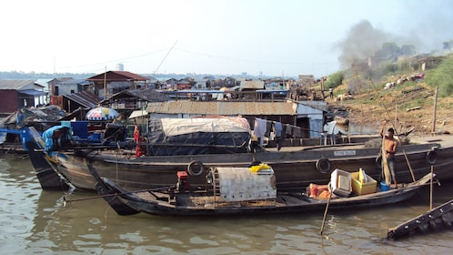 boats docked on the banks of the mekong river