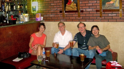 Drinkers enjoying a beer at a bar in Hollywood.