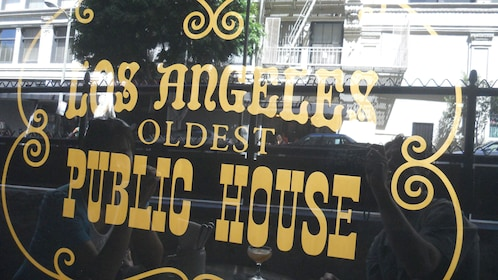 Ornate window sign for a pub in Hollywood.