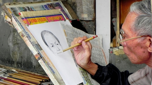 Portrait artists at the market in Hong Kong