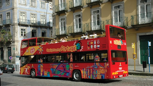 City Sightseeing bus touring down the streets of Funchal