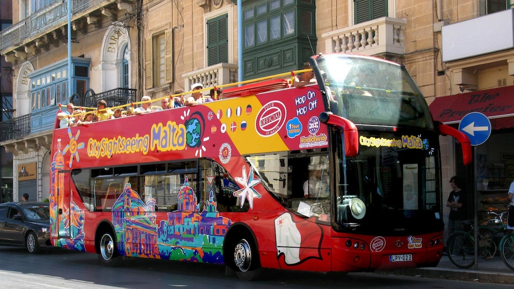 City Sightseeing bus touring down the streets of Malta