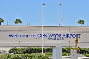 John Wayne Airport (SNA): Private Transfer From Anaheim Resort.