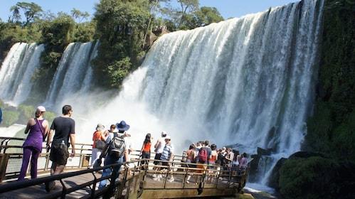 crossing the waterfall bridge at Iguassu Falls in Argentina