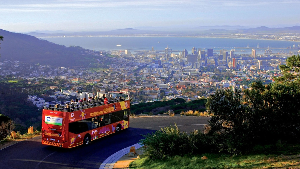 Show item 1 of 8. Double deck bus traveling on the outskirts of the city in South Africa