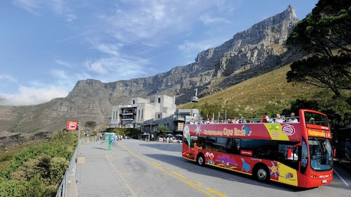 Double deck bus traveling along Table Mountain in South Africa
