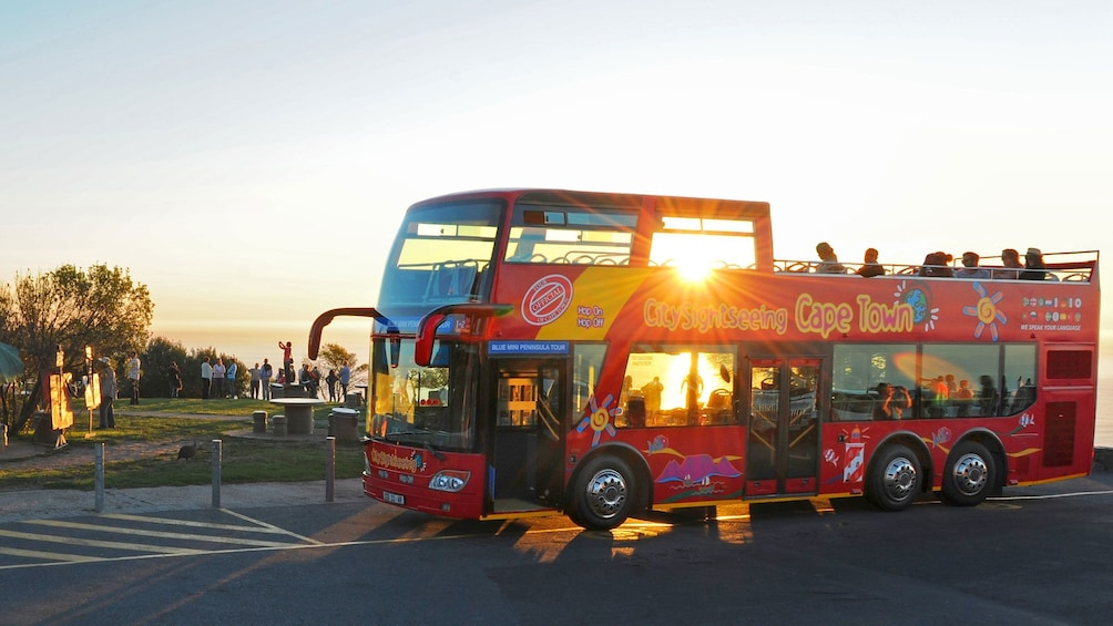 Show item 3 of 8. Bus stopping to catch the sunset in South Africa