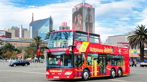 City Sightseeing tour bus traversing the streets of Johannesburg