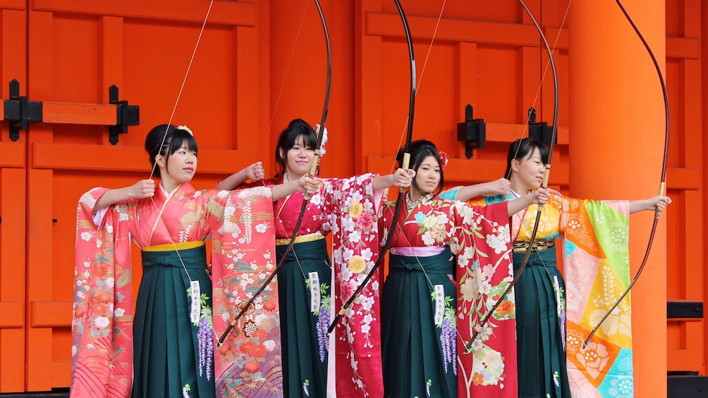 Show item 1 of 10. women with bows in Tokyo