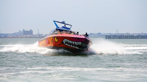 The Godzilla Thrill Boat crashing through water off the coast of Boston