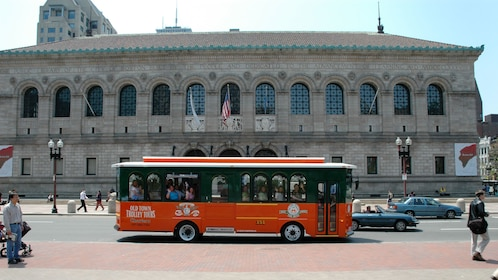 Trolley driving past the Boston Public Library