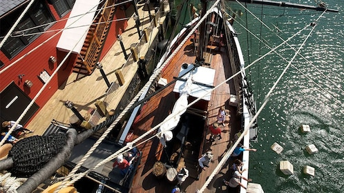 Boston Tea Party Museum guests tip bags of tea overboard in Boston