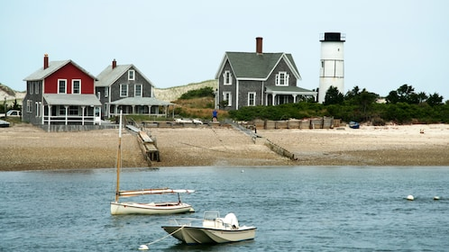 Anchored boats and seaside homes in Cape Cod