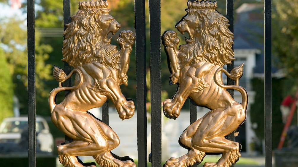 Show item 2 of 5. Lions on a wrought iron gate of a mansion in Newport