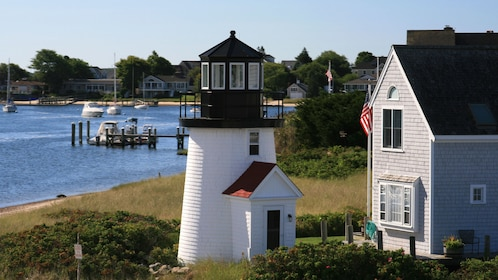 Lighthouse and homes in Cape Cod